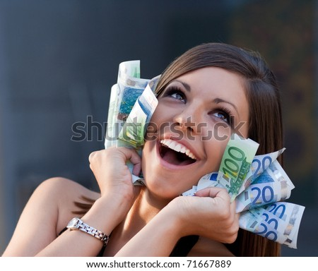 Beautiful joyful girl with Euro bills. Please check similar images in my portfolio. - stock photo
