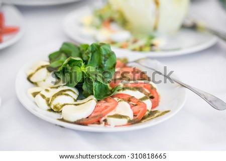 Beautiful juicy salad on a celebratory banquet, wedding, anniversary, banquet - stock photo