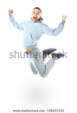 Beautiful jumping man isolated on white background - stock photo
