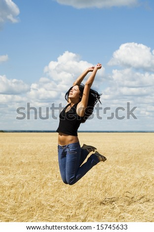 beautiful jumping woman over nature background