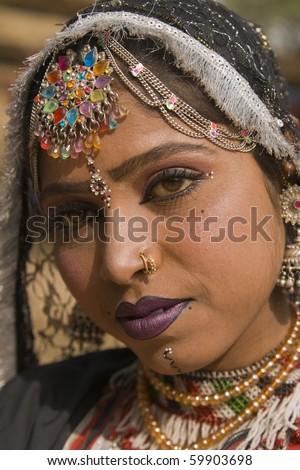 Beautiful Kalbelia dancer in traditional costume at the annual Sarujkund Fair near Delhi in India. - stock photo