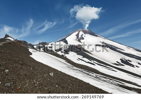 Beautiful Kamchatka volcanic landscape: Avachinsky Volcano - active volcano of Kamchatka Peninsula. View of the fumarolic activity of volcano, steam and gas emissions from crater. Russia, Far East. - stock photo