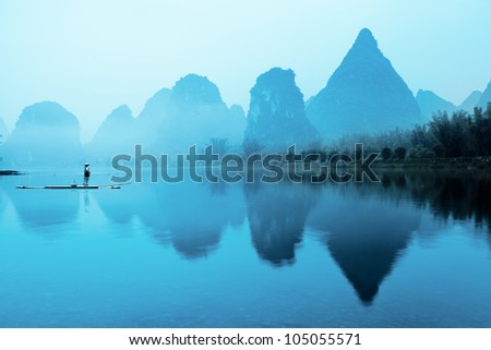 beautiful karst mountain landscape with bamboo raft in yangshuo,guilin,China - stock photo