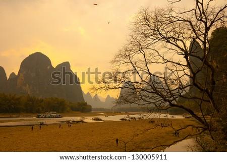 Beautiful Karst mountain sunset landscape in Yangshuo Guilin, China - stock photo