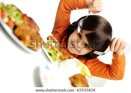 beautiful kid boy is about to eat, real enjoying food - stock photo