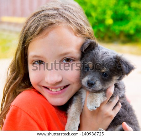 Beautiful kid girl portrait with puppy chihuahua gray dog - stock photo