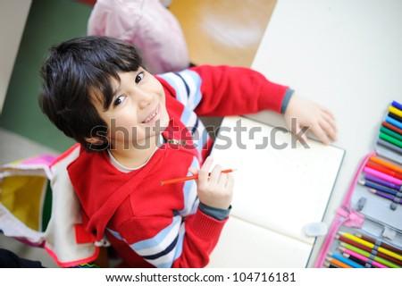 Beautiful kid in school - topview angle - stock photo