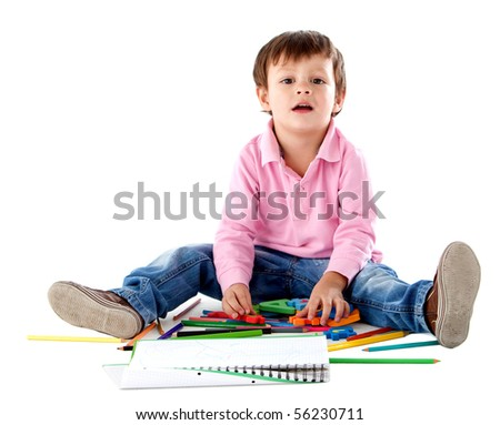 Beautiful kid on the floor with color pencils - isolated over a white background