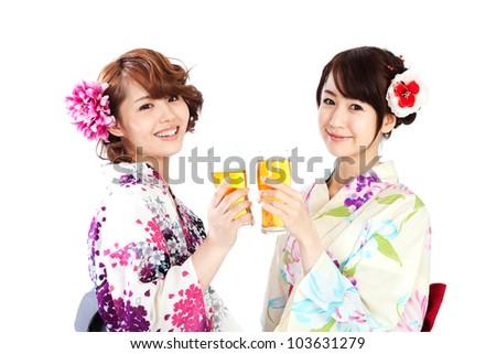Beautiful kimono woman drinking beer. Portrait of asian woman. - stock photo