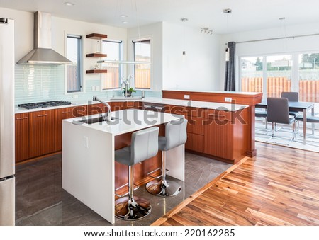 Beautiful Kitchen and Dining Area in New Home - stock photo
