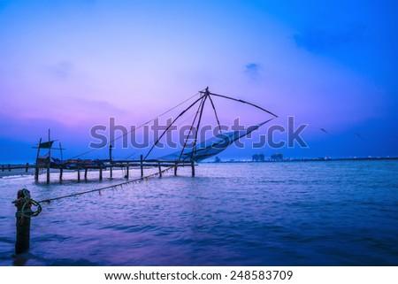 Beautiful Kochi chinese fishnets in twilight Kochi, Kerala. Fort Kochin, Kochi, Kerala, south India - stock photo