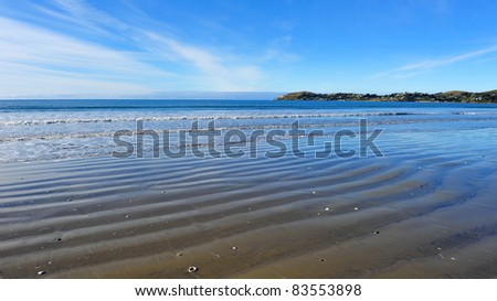 Beautiful KoeKohe beach at Otago coast of New Zealand. The beach is famous for the Moeraki boulders. - stock photo