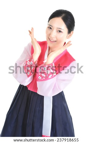 Beautiful korean woman standing with hand on chin isolated on white background  - stock photo