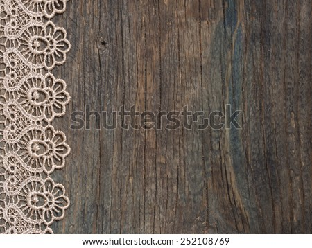 beautiful lace on the wooden background, vintage - stock photo