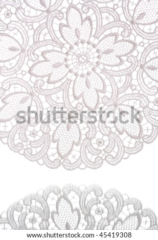 Beautiful lace reflecting in glass, isolated on white. - stock photo