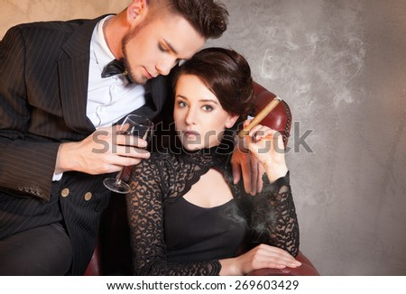 Beautiful lady and gentleman have date - posh, retro style - stock photo