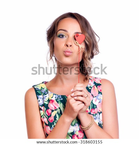 Beautiful lady blows a kiss, isolated on white - stock photo