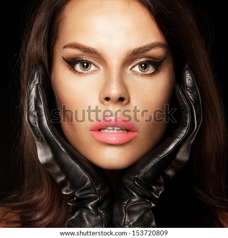 Beautiful lady. Coral Lips and leather gloves evening make up, perfect skin - stock photo