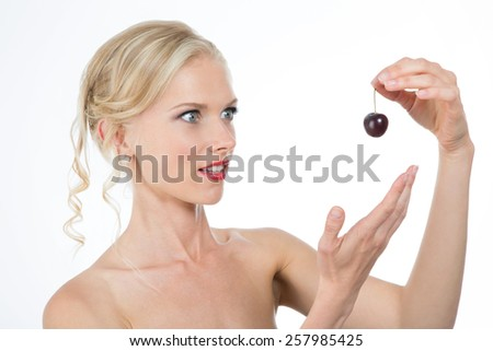 beautiful lady desire eating healthy cherry  - stock photo