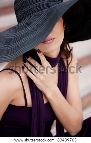 beautiful lady in a hat - stock photo