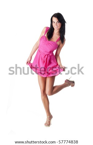 beautiful lady in a pink dress posing on white background
