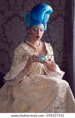 Beautiful lady in baroque dress - stock photo