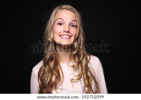 Beautiful lady in front of a black background