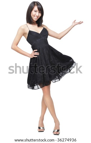 Beautiful lady in glamorous little black dress makes a sexy hand gesture to welcome, present and invite.