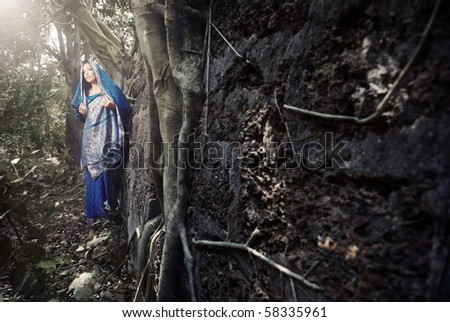 Beautiful lady in the blue traditional sari in a Bollywood movie. India - stock photo