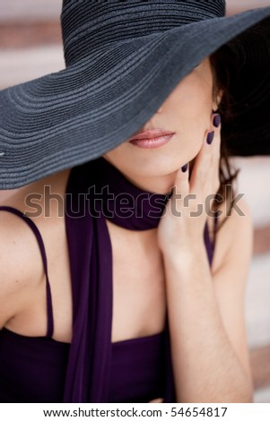 beautiful lady in the hat - stock photo