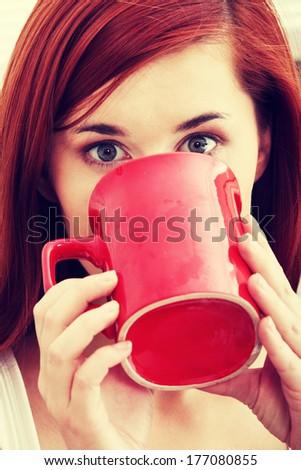 Beautiful lady is drinking coffee - stock photo