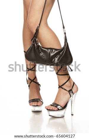 beautiful lady long legs on high heels and black handbag over white