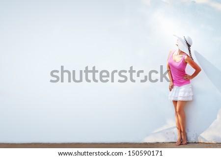 beautiful lady posing at white wall - stock photo