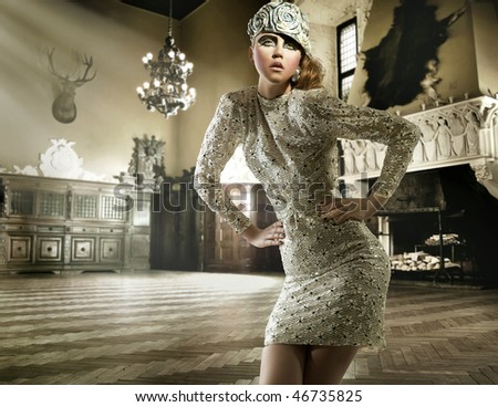 Beautiful lady posing in a vintage interior - stock photo
