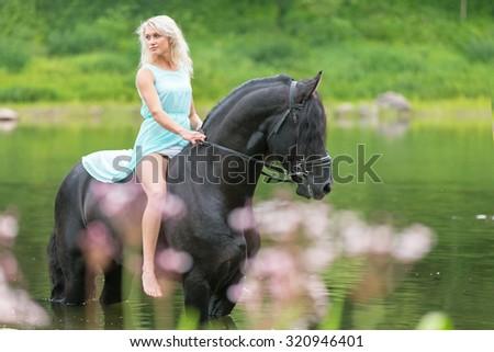 Beautiful lady riding bareback. - stock photo