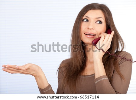 beautiful lady secretary speaking on the phone - stock photo