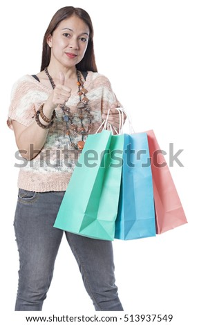 Beautiful lady shopper in thumbs up. Isolated in white background.