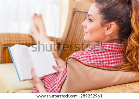 Beautiful lady sitting and reading her book. - stock photo