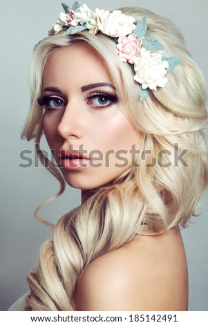 Beautiful lady with a wreath of flowers - stock photo