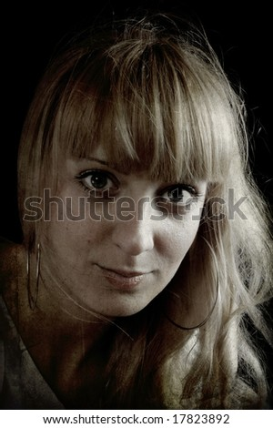Beautiful lady with big bright eyes and blond hair. Texture effect added.