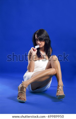 Beautiful lady with condom in her hand - stock photo