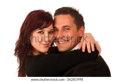 Beautiful lady with her arms around her handsome smiling boyfriend