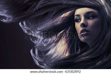 Beautiful lady with long brown hair, at moonlight - stock photo