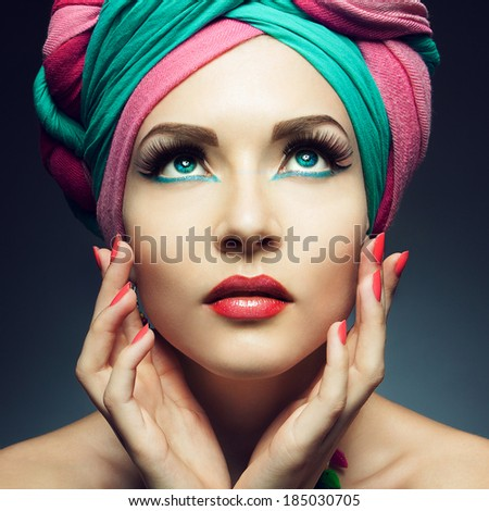 Beautiful lady with multi-colored turban and necklace - stock photo