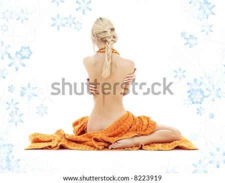 beautiful lady with orange towels and snowflakes - stock photo