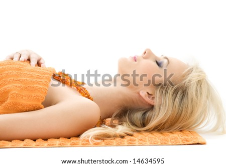 beautiful lady with orange towels in spa salon - stock photo