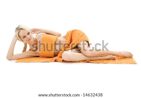 beautiful lady with orange towels over white - stock photo