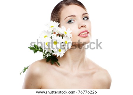 Beautiful lady with white flowers studio photo