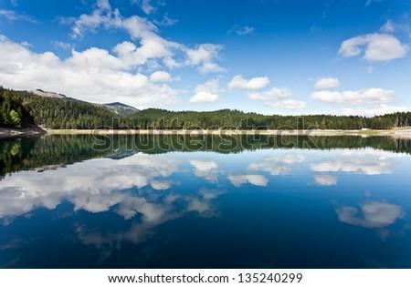 Beautiful lake and clouds reflections - stock photo