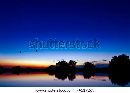 Beautiful lake at sunset - stock photo